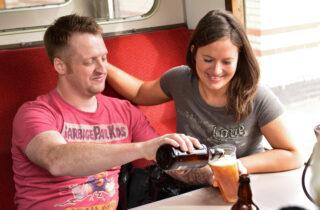 Rail Ale Trail Couple Pouring Ale